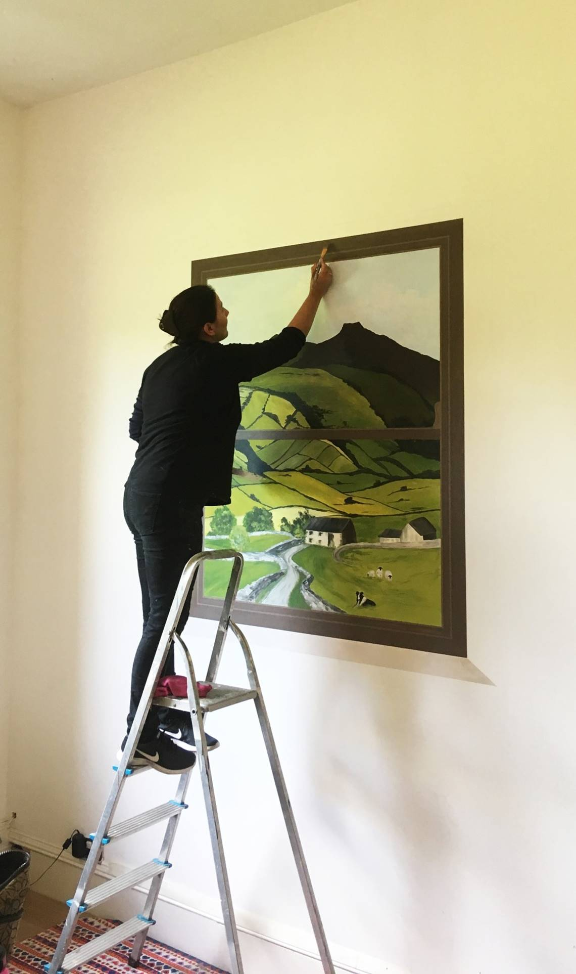 Joanna Perry Painting Window Mural.jpg